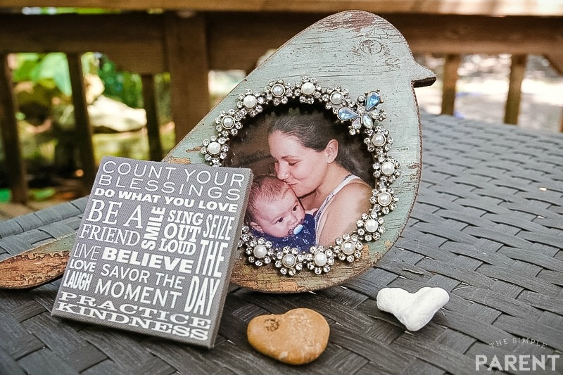 Photo frame with heart shaped rocks