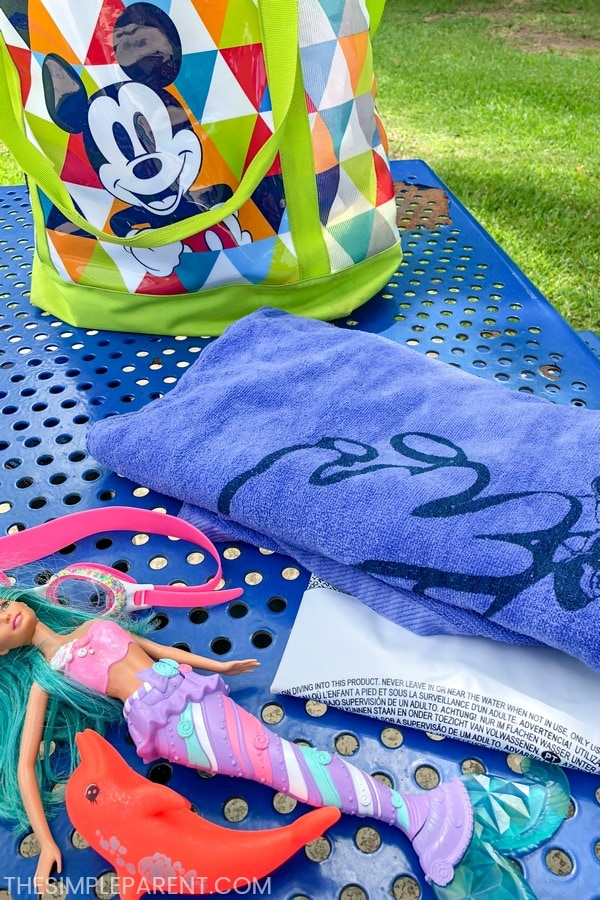 Pool bag with towels and pool toys