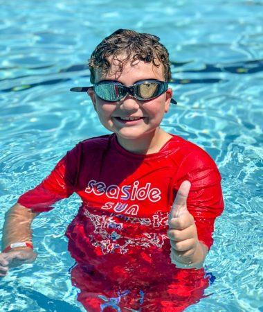 Boy wearing goggles in the swimming pool