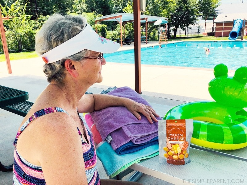 Woman having snacks for keto diet at the pool