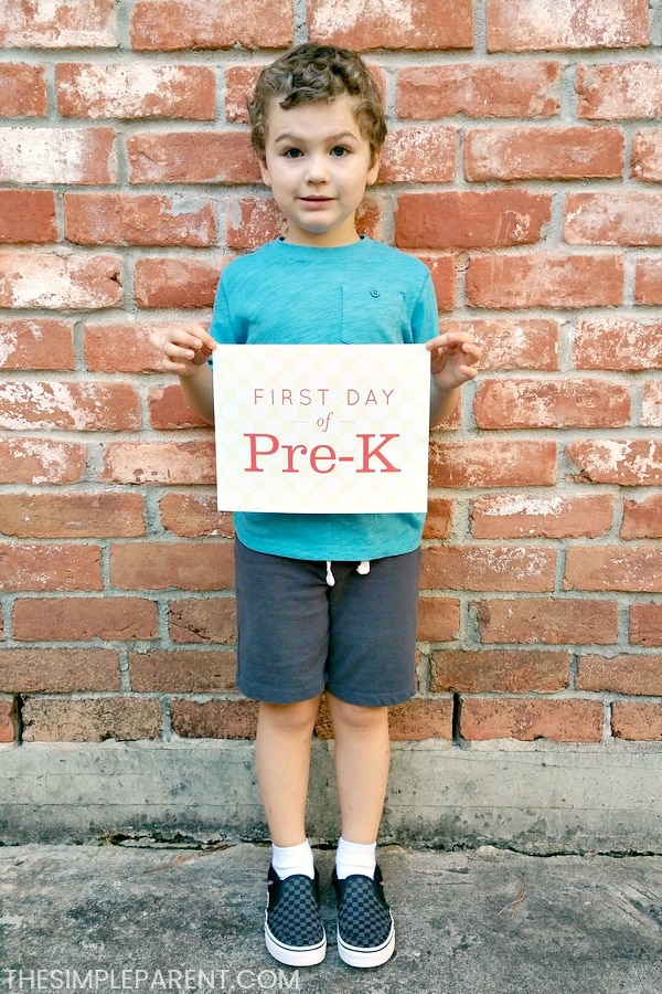 Boy holding first day of school Pre-K sign