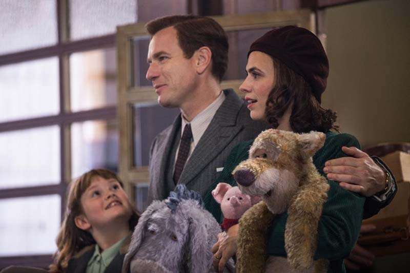 Hayley Atwell holding WInnie the Pooh characters in Christopher Robin Movie