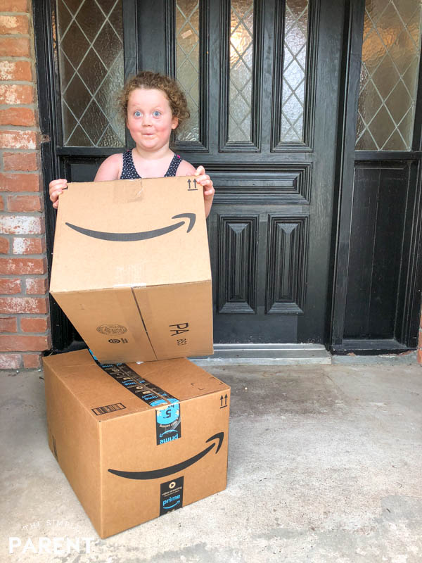 Girl bringing Amazon boxes in the house