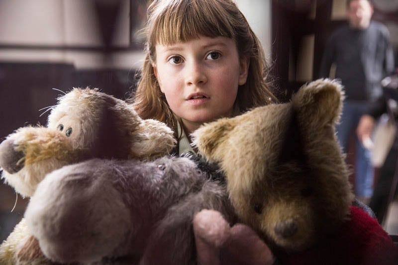 Bronte Carmichael with stuffed animals in Christopher Robin