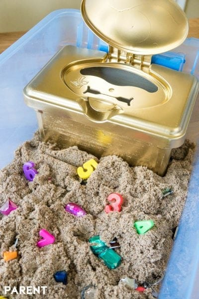 DIY treasure chest in a Kinetic Sand sensory bin