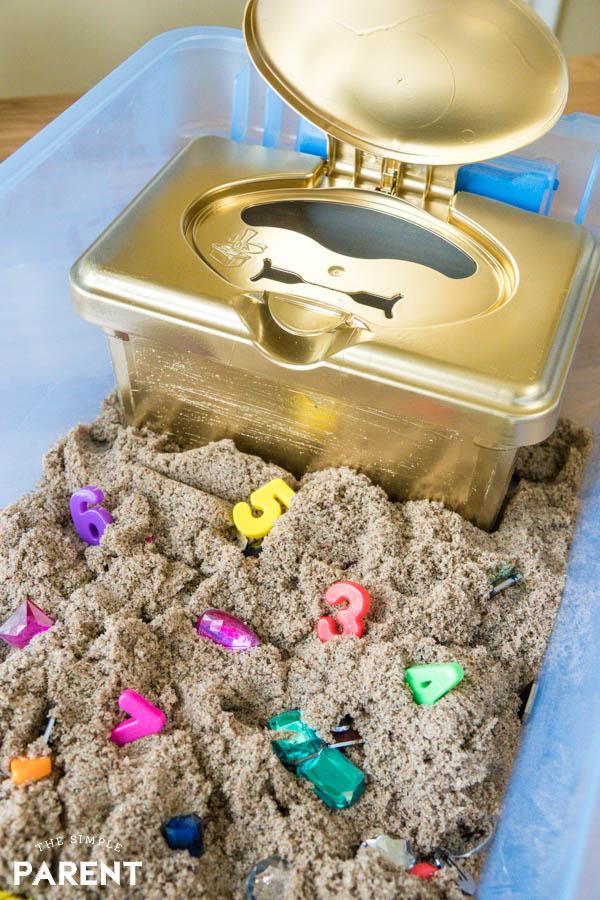 DIY treasure chest in a Kinetic Sand sensory bin