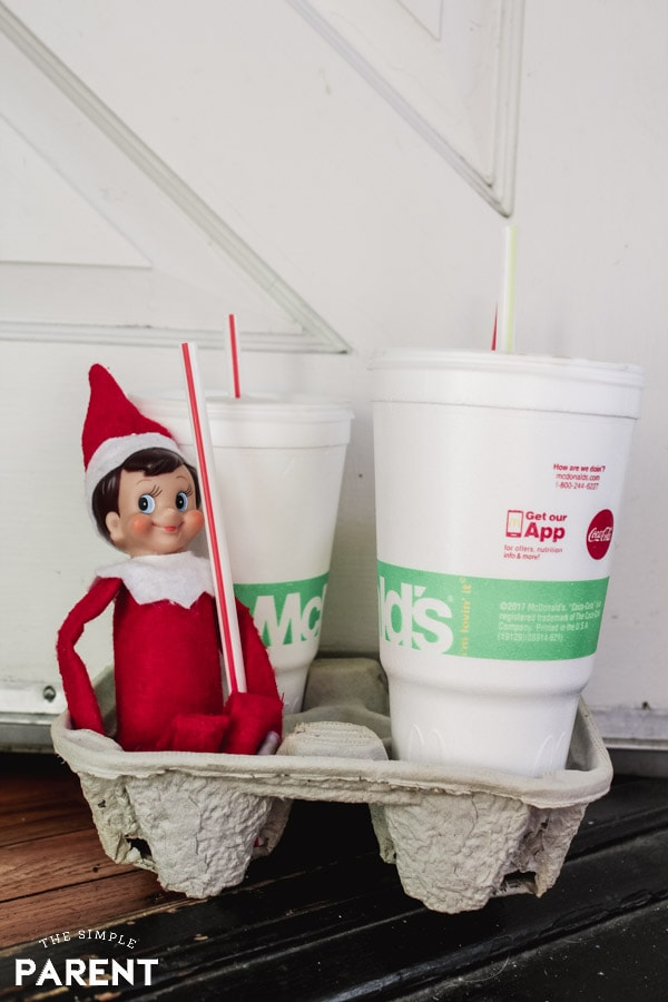 Elf on the Shelf arrival with McDonald's drinks