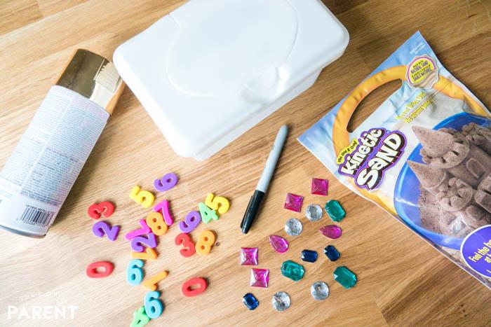 Materials to make a DIY treasure chest sensory bin