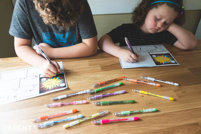 Kids using make your own comic book printable pages