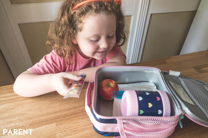 Girl helping packing lunch for school