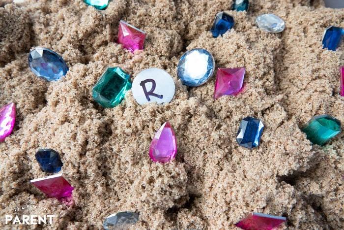Kinetic Sand beach sand treasure hunt sensory bin