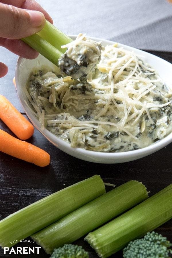 Bite of Crockpot Spinach and Artichoke Dip