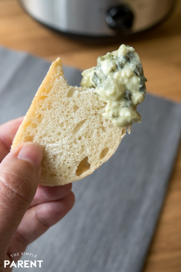 Piece of bread with Crockpot Spinach Dip