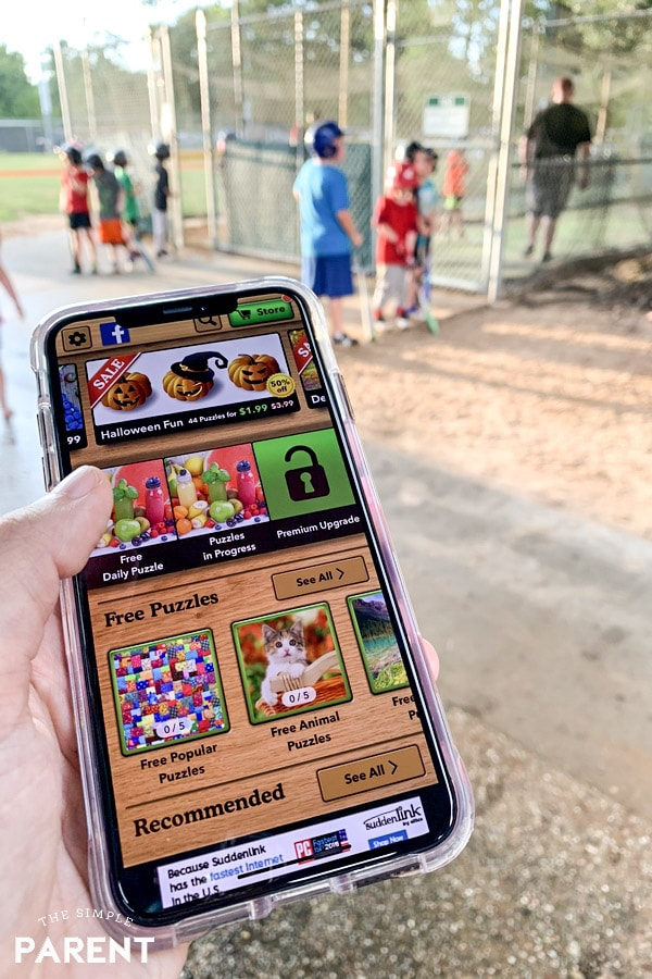 Playing Jigsaw Puzzle app at baseball practice