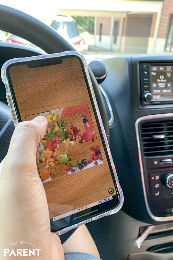 Playing Jigsaw Puzzle app in the car