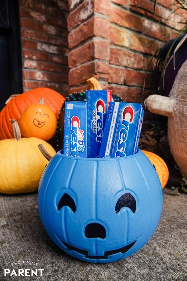 Crest toothpaste in a Halloween pumpkin bucket
