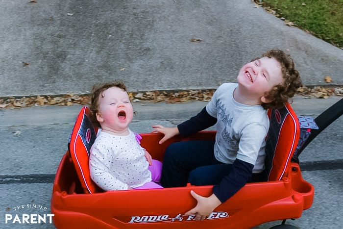 Kids laughing while riding in a Radio Flyer Wagon