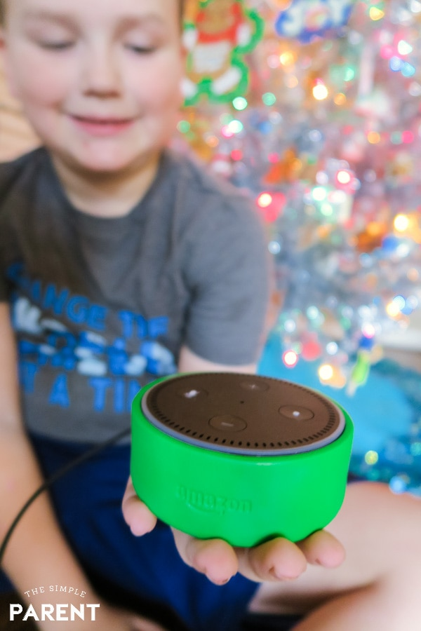Child holding Amazon Echo Dot Kids Edition