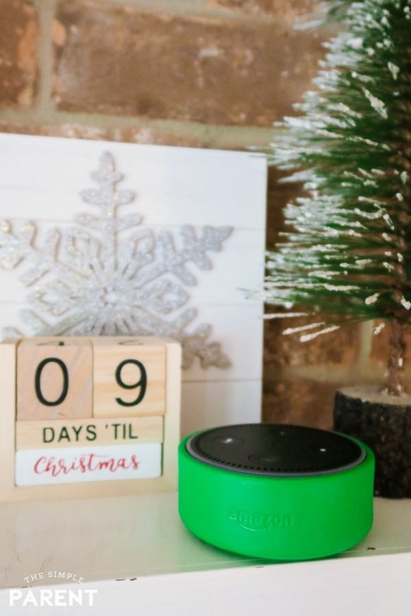 Amazon Alexa Echo Dot Kids Edition next to Christmas Countdown sign on mantle