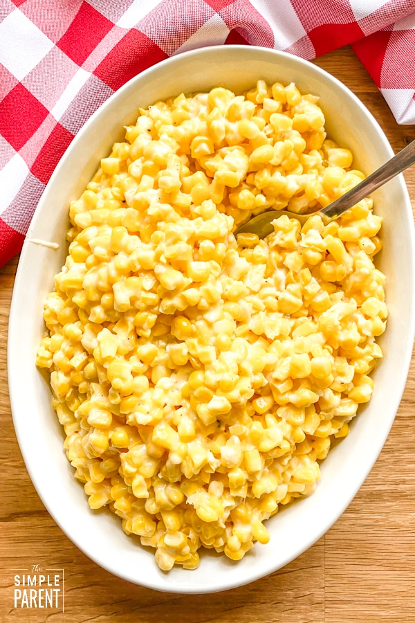 White dish of Christmas corn made on the stovetop
