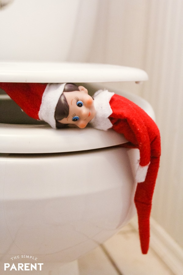 Elf on the Shelf on the toilet
