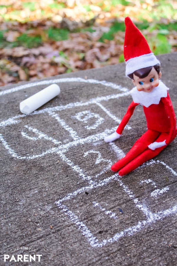 Elf on the Shelf playing hopscotch