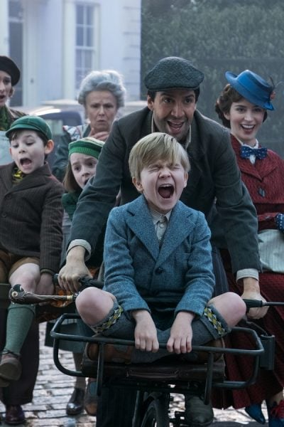 Joel Dawson and Mary Poppins Returns cast on the bicycle