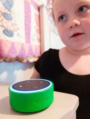 Girl using Amazon Alexa Echo Dot Kids Edition device