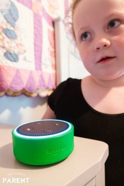 Girl using Amazon Alexa Echo Dot Kids Edition device