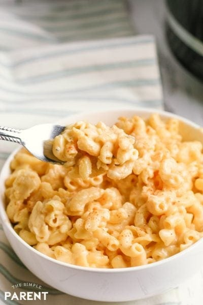 Learn how to make this easy Crock Pot mac and cheese using Velveeta and a mix of cheeses for great flavor! Use uncooked macaroni with Evaporated Milk in the slow cooker for the best no boil recipe for a a crowd or just dinner for your family!