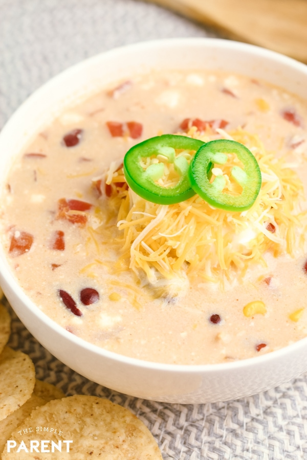 Bowl of crockpot white chicken chili cream cheese recipe