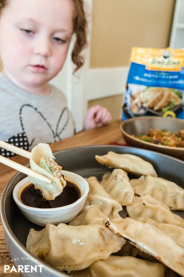 Girl eating Ling Ling Potstickers made with chicken