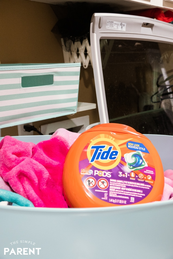 Organized laundry room with Tide detergent