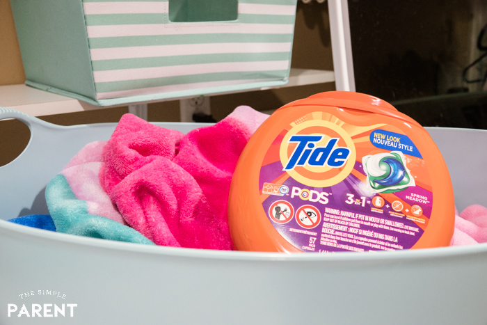 Tide laundry detergent PODS in a laundry basket
