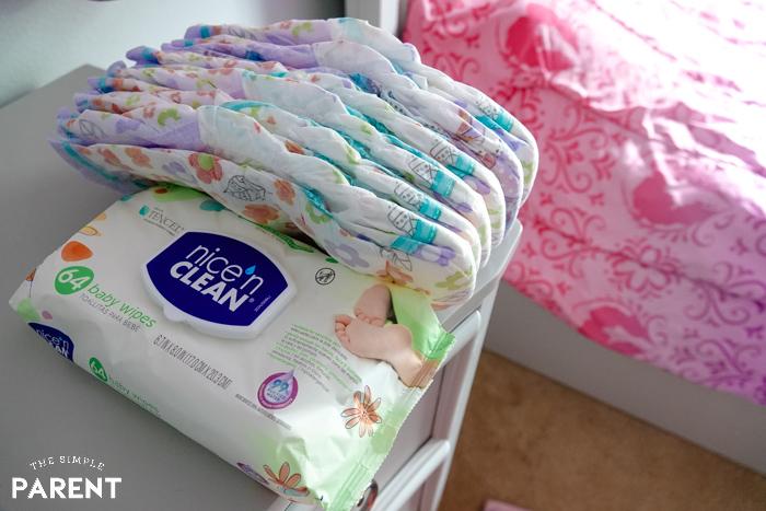 Nice 'n Clean Baby Wipes and diapers in bedroom