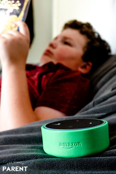 Boy reading a book with Alexa on Amazon Echo Dot Kids Edition