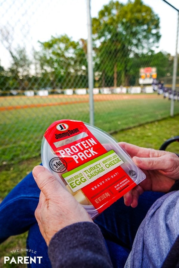 Enjoying a Jimmy Dean Protein Pack at the baseball field