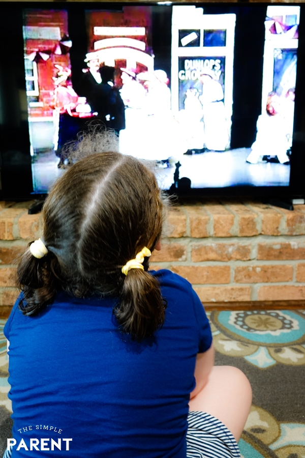Girl watching digitized VHS home movie