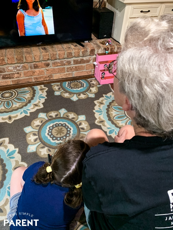 Grandmother and granddaughter sitting together watching old photos that have been digitized by Legacybox