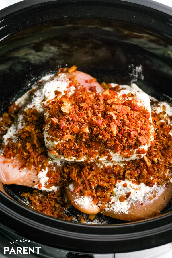 Bacon and other ingredients in slow cooker crack chicken