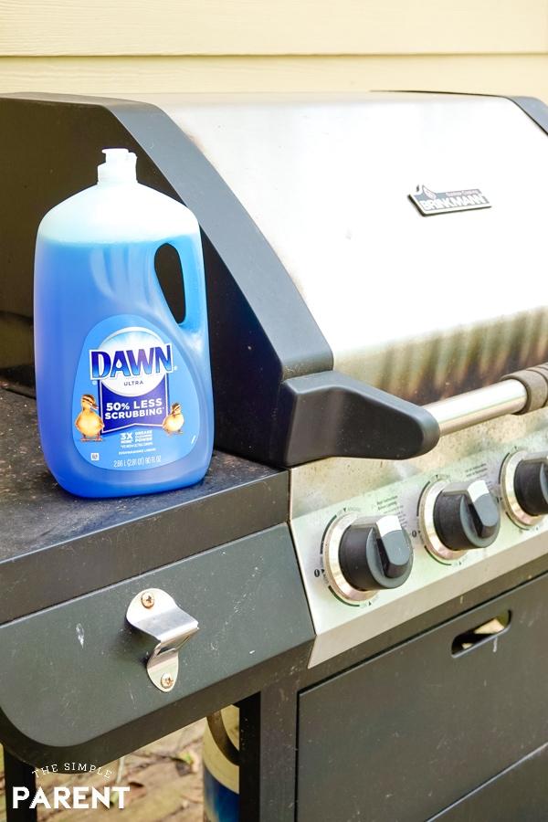 Dawn dish soap sitting on dirty gas grill