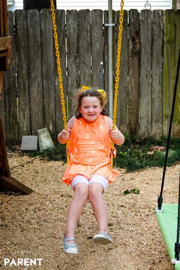 Girl swinging on swingset