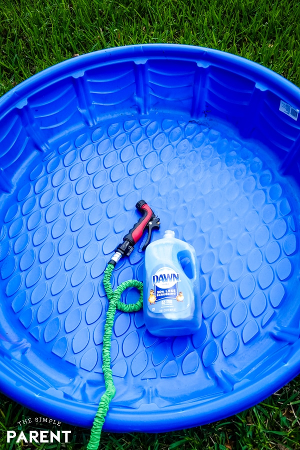 Cleaning kiddie pool with Dawn and water hose