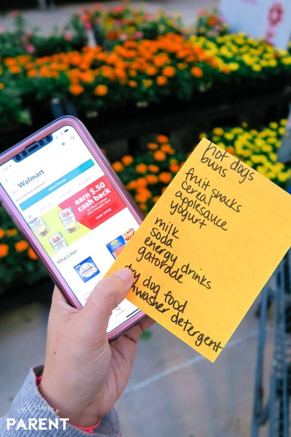 Grocery shopping list and Ibotta app on phone at Walmart