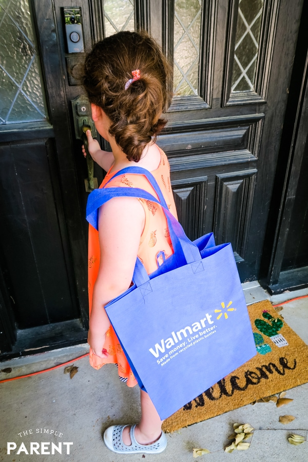 Young girl with Walmart grocery shopping bag