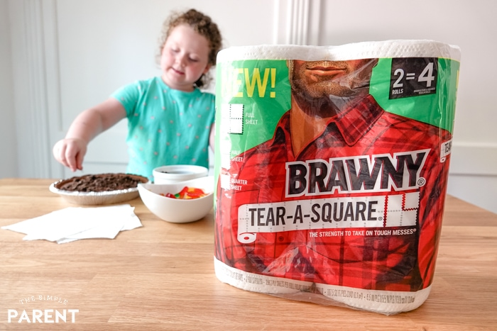 Brawny® Tear-A-Square®in the kitchen while girl cooks