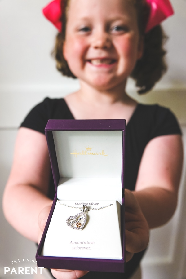Girl holding heart pendant from Hallmark Jewelry at Amazon.com