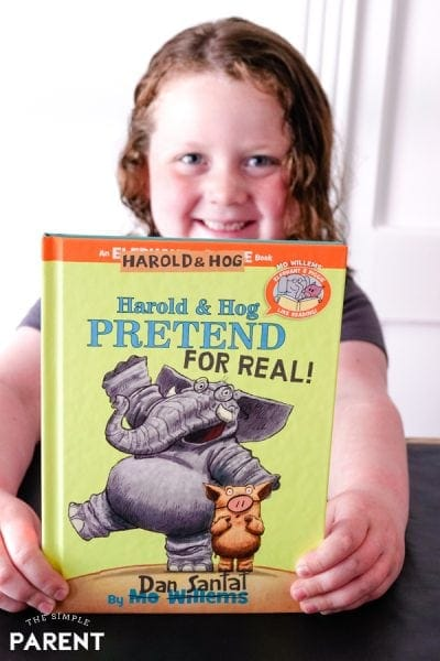 Girl holding Harold and Hog Pretend for Real! book