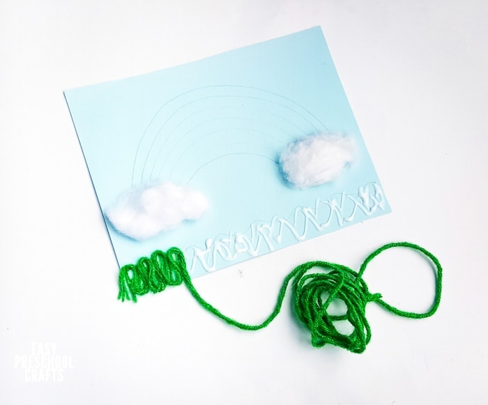 Using yarn to make grass on kids craft