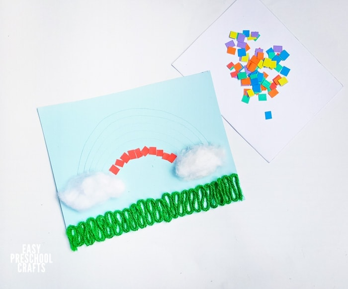 Gluing red paper squares on rainbow paper craft